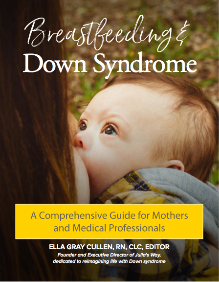 Image of Book with baby breastfeeding.